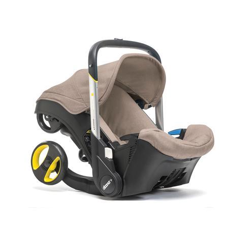 DOONA Babyschale Doona Plus beige (dune) mit voll integriertem Fahrgestell, 2 in 1