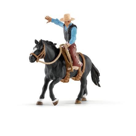 Schleich  Osedlaný kůň s kovbojem 41416