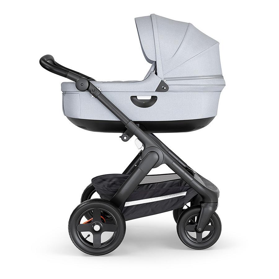 STOKKE® Kinderwagen Trailz™ Black/Black mit Geländerädern und Tragewanne Grey Melange