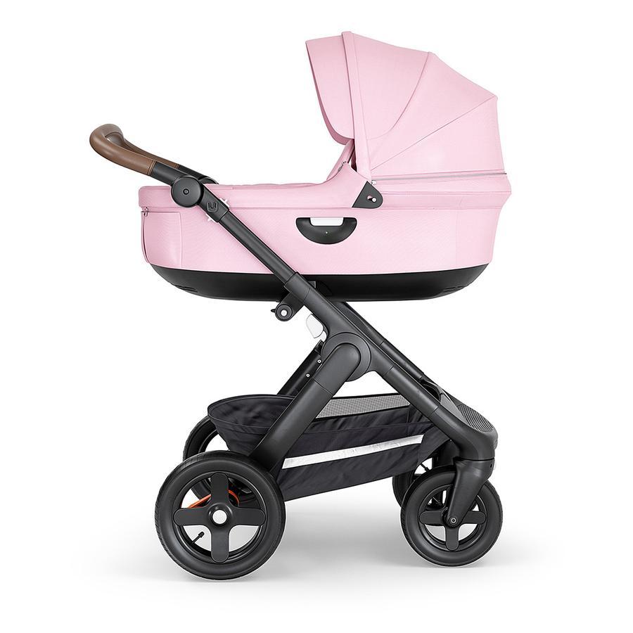 STOKKE® Kinderwagen Trailz™ Black/Brown mit Geländerädern und Babyschale Lotus Pink