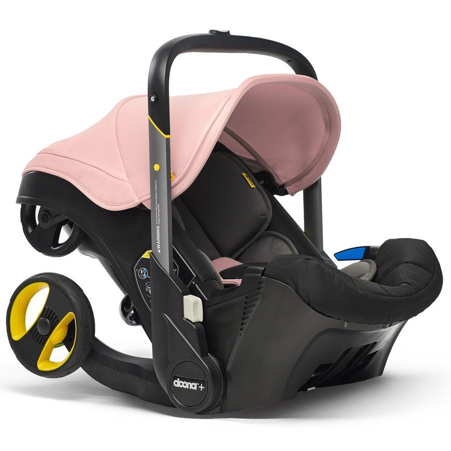 doona Babyschale Blush Pink / rosé mit voll integriertem Fahrgestell, 2 in 1